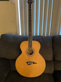 Brand new Dean electric acoustic bass with soft cover case