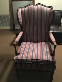 Brown wooden framed red and white striped padded armchair