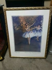 brown wooden framed painting of woman Montréal, H8N 1B2