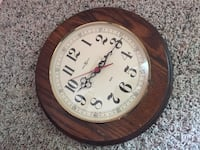 round brown wooden frame analog wall clock