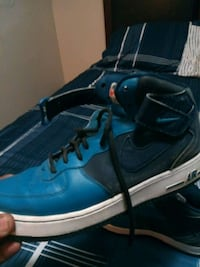 blue-and-black Nike basketball shoes