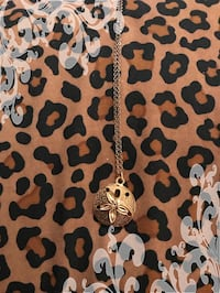 Goldtone sand dollar charm and necklace Slidell, 70461