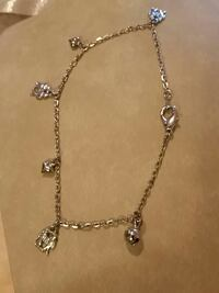 Silver Anklets with Charms.
