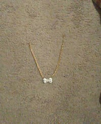 silver bow pendant with gold chain necklace Montgomery, 36116