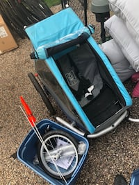 Croozer covered 3 wheel stroller. Mint condition. Used less than a dozen times