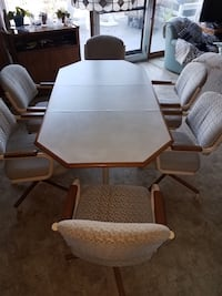 Kitchen table and 6 chairs. Table has a leaf that can be removed