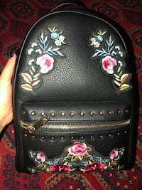 Black and pink floral leather backpack Toronto, M3C 1B7