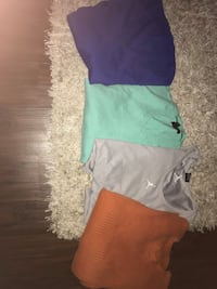 Bags of men and women's and kids clothes both boys and girls
