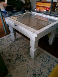 Glass top window pane table with written music inside