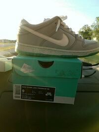 pair of gray Nike Air Max shoes with box