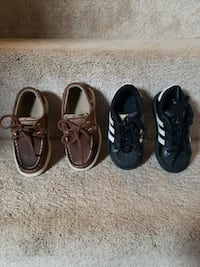 two pairs of black and white shoes Herndon, 20170