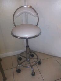 Adjustable Leather Bar Stools. One With Wheels. Fort Lauderdale