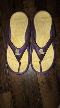 Pair of purple-and-black nike flip flops Youngsville, 70592