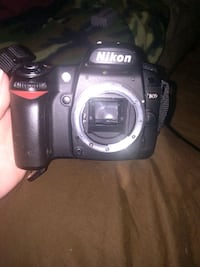 Nikon d80 digital camera with lens and tripod