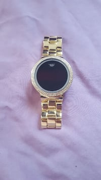 Gold touch screen watch. Scotland County