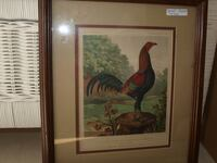 brown wooden framed painting of woman Raleigh