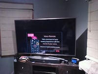 black flat screen TV with black wooden TV stand Enfield, 06082