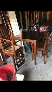 Brown wooden dinner table set needs new home Meraux, 70075