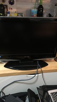 black Sharp flat screen television