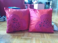two red/black floral throw pillows