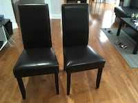 Two brown faux leather dining chairs Langley, V2Y 3E6