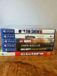 assorted Sony PS4 game cases