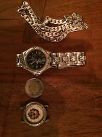 silver and gold analog watch Montréal, H2G 1Z1