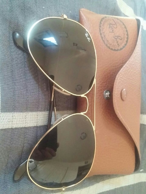 3257b20930c Used gold frame Ray Ban aviator style sunglasses with case for sale in  Saskatoon