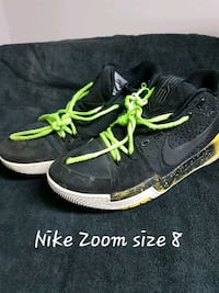 pair of black-and-green Nike running shoes Carvel, T0E 0H0