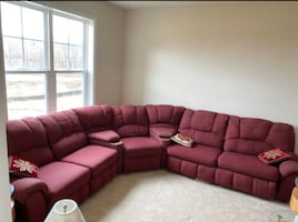 Red sectional sofa with recliners and sofa bed