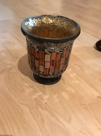 brown and brass-colored vase