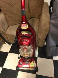 red and black Bissell upright vacuum cleaner Coquitlam, V3K 3P4