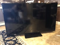black flat screen TV with remote Warwick, 02888