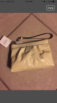 Women's beige coach wristlet screenshot