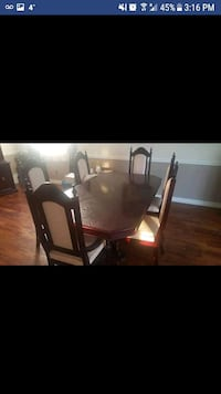 rectangular brown wooden table with chairs 558 km