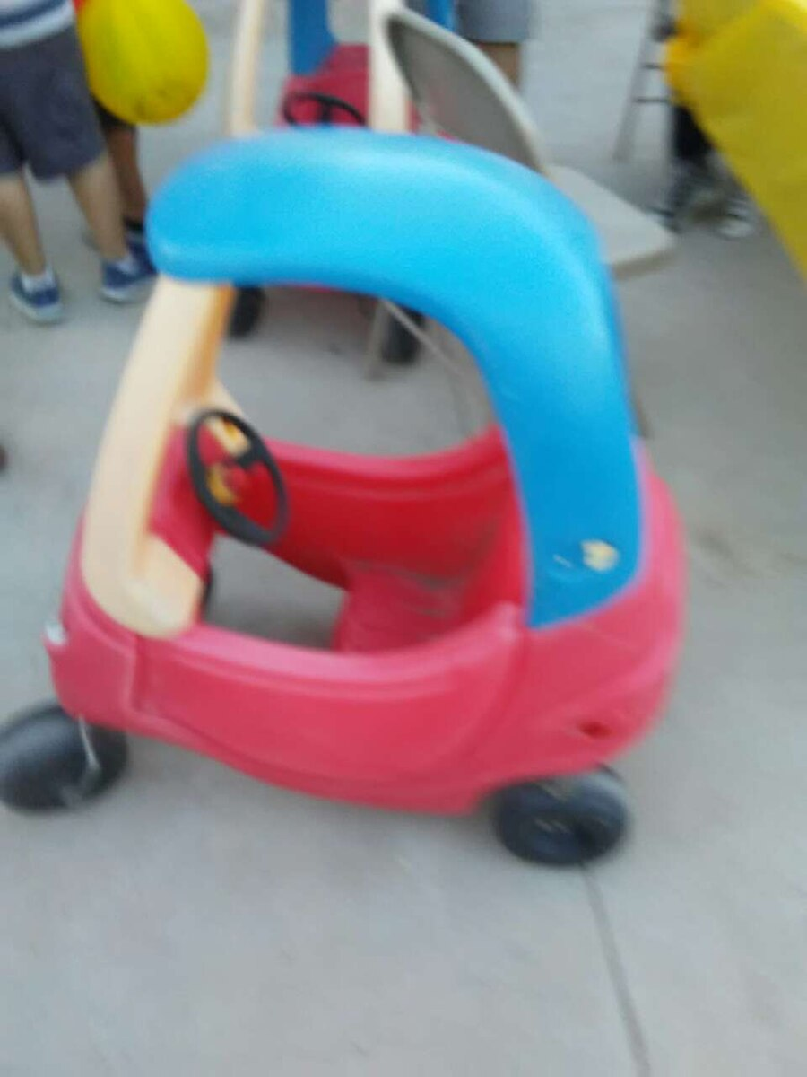 blue, yellow, and red plastic ride-on car