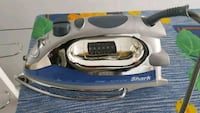 gray and blue Shark clothes iron