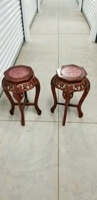 2 octagonal brown wooden tables