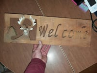 brown welcome signage