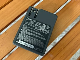 Bundle - Canon charger, battery extender, and battery