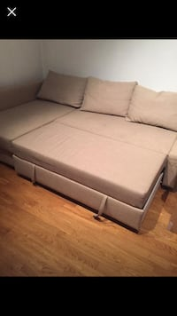 Ikea corner sofa bed with storage. beige. ok condition, not new. comfortable and offers a pull out bed and storage.