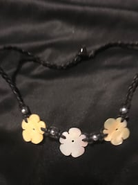 Black necklace with flower shaped pearls Calgary, T2A 6C8