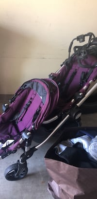 baby's purple and black stroller Houston, 77005