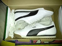 white-and-black Puma low top sneaker in box