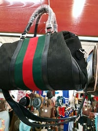 black, green, and red duffel bag Montreal, H3N 2R6