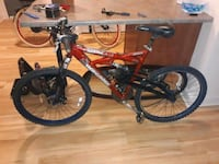 red and black full suspension mountain bike Knoxville, 37921