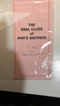 """Ali autograph on """"The real cause of man's distress"""""""