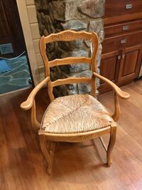brown wooden framed brown padded armchair 40 km