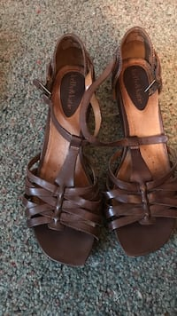 Women's pair of brown leather open-toe sandals
