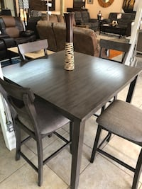 rectangular brown wooden table with four chairs dining set Houston, 77041